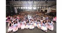 BNK48's second generation members pose for a photo with their fans.