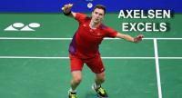 Viktor Axelsen of Denmark hits a shot against Huang Yuxiang of China
