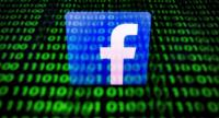 In this file photo taken on April 26, 2018 in Paris shows the logo of social network Facebook displayed on a screen and reflected on a tablet./AFP