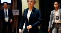 South Korea's Foreign Minister Kang Kyung-wha (C) arrives to meet US Secretary of State Mike Pompeo on the sidelines of the 51st Association of Southeast Asian Nations (ASEAN) Ministerial Meeting (AMM) in Singapore on August 4, 2018./AFP