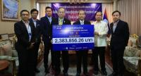 Nation Multimedia Group Executive Director Marut Arthakaivalvatee (fourth from left) yesterday presents over Bt2 million in donation money to help flood victims in Laos to Lao ambassador Seng Soukhathivong (fifth from left) at the Lao Embassy.