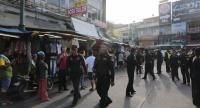 BMA officials are dispatched to enforce the ban on roadside vending on Khaosan Road on August 1.