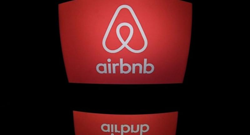 This file photo taken on March 02, 2017 shows the logo of online lodging service Airbnb displayed on a computer screen in Paris./AFP