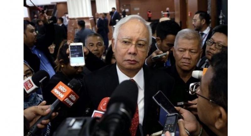 Najib Razak answers media questions after the SST debate at Parliament on Aug 7. // Bernama