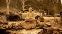 A Buddha statue is seen at a burned home in Spring Valley, near Clearlake Oaks, northern California, on August 7.//AFP
