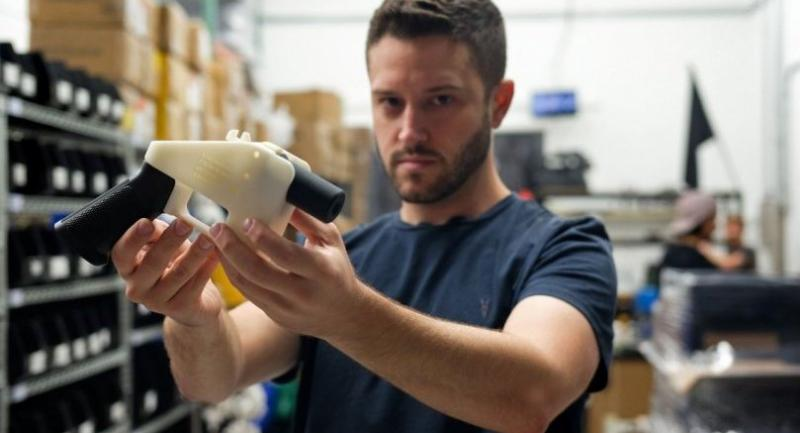 Cody Wilson, owner of Defense Distributed company, holds a 3D printed gun, called the