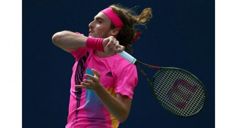 Stefanos Tsitsipas of Greece plays a shot against Novak Djokovic of Serbia.
