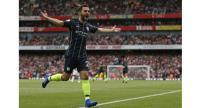 Manchester City's Portuguese midfielder Bernardo Silva celebrates after scoring their second goal.
