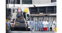 File photo : A white van used in the attack on London Bridge is seen hoist on top of a flat-bed truck as police forensics officers work on London Bridge in London on June 4, 2017.//AFP