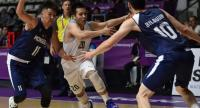 Thailand's Sirapong Boonyai (C) is challenged by Mongolian players in their men's basketball preliminary Group A game between Thailand and Mongolia during the 2018 Asian Games in Jakarta.