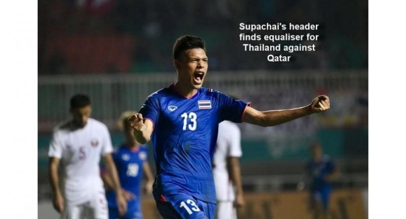 Supachai Chaided reacts after scoring a goal for Thailand.