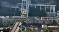 This general view taken on August 15, 2018, shows abandoned vehicles on the Morandi motorway bridge after a section collapsed in the north-western Italian city of Genoa.//AFP