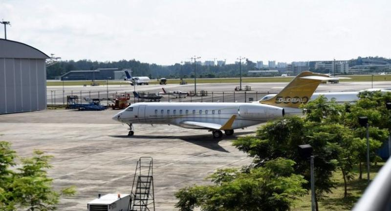 This photo taken on February 6, 2017 shows a Bombardier Global 5000 plane without a body number is seen parked on the tarmac of Seletar airport in Singapore.//AFP