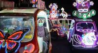 Joyriding in Jogya by illuminated bicycle car. It's family fun as residents gather in Yogyakarta's Southern Square to scoot about in pedalpowered roadsters decorated to look like Doraemon or Pikachu, with pop songs blaring.