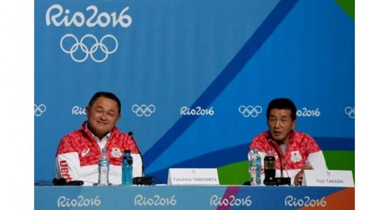 Japan's Rio Olympic games delegation general manager Yuji Takada (right) answers a question beside then deputy chairman Yasuhiro Yamashita (left) during the Japan Olympic Committee's press conference in Rio de Janeiro on Aug 1, 2016./AFP