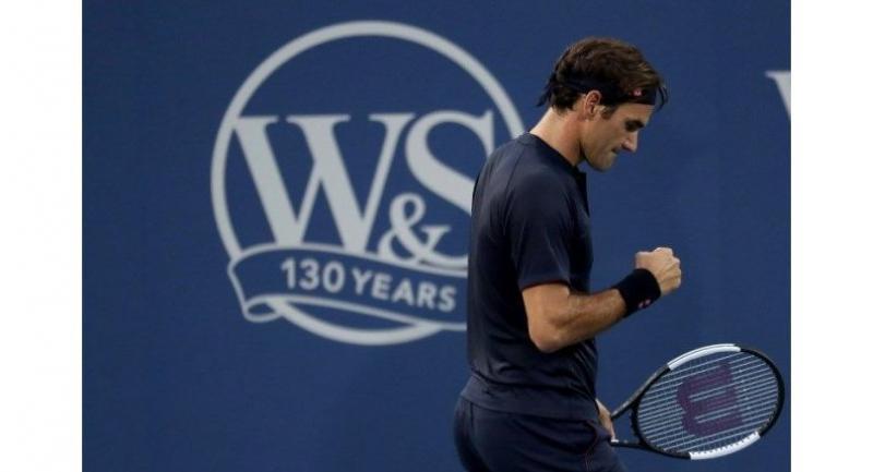 Roger Federer of Switzerland celebrates a point against David Goffin of Belgium.
