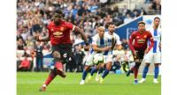 Manchester United's French midfielder Paul Pogba scores from a late penalty kick for their second goal .