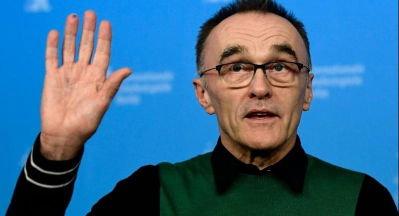 In this file photo taken on February 10, 2017, British director Danny Boyle poses for photographers during a photocall for the film
