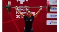 Hidilyn Diaz of Philippines competes in the women's 53kg weightlifting event during the 2018 Asian Games in Jakarta on August 21, 2018.