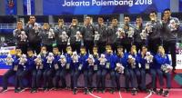 Thailand's sepak takraw players and officials pose for photographers after winning the men's and women's team regu finals.