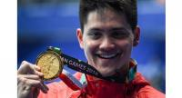 Gold medallist Singapore's Joseph Schooling celebrates during the victory ceremony for the men's 100m butterfly .