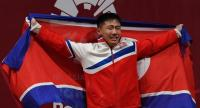 Gold medallist O Kang Chol of North Korea celebrates on the podium.