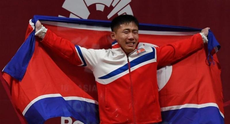 Gold medallist O Kang Chol of North Korea celebrates on the podium.