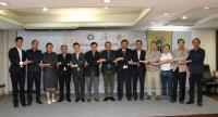 Representatives of the member countries of the Confederation of Asean Journalists link arms for a photo session to demonstrate their commitment to fight against fake news at a forum held in Bangkok on Tuesday.
