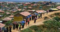 Rohingya refugee volunteers walk along Balukhali refugee camp in Ukhia district near Cox's Bazar on August 23, 2018./AFP