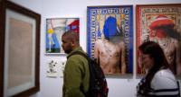 """People visit the """"Queermuseu"""" exhibition at Parque Lage park, home to the Visual Arts School, in Rio de Janeiro, Brazil. / AFP Photo"""