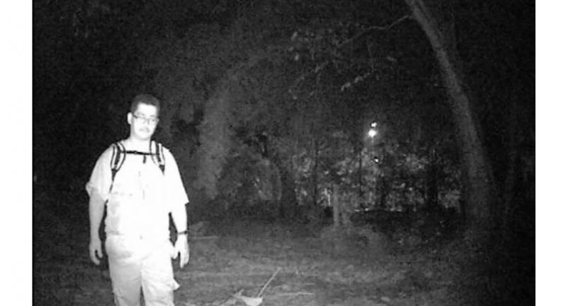 Augustine Towonsing during a solo ghost research in a cemetery. Photo: Augustine Towonsing