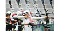 South Korea's Kong Chaeyong (C) takes part in the qualification round recurve women's archery at the 2018 Asian Games in Jakarta on August 21, 2018.