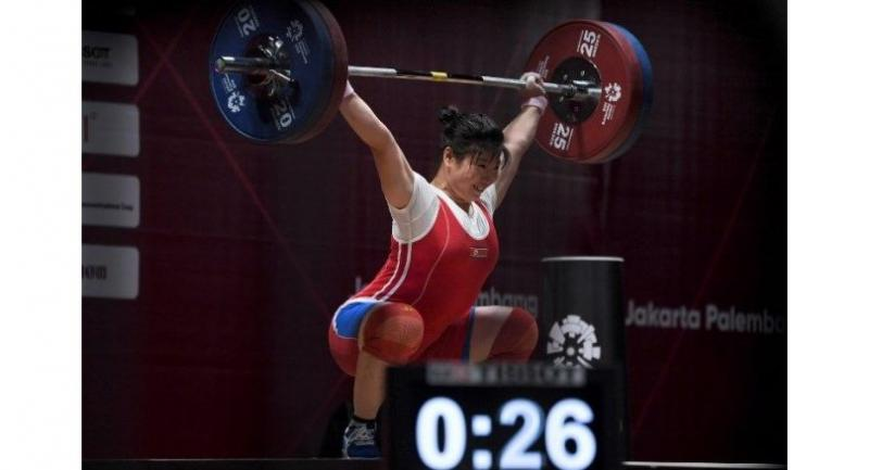 North Korea's Rim Jong Sim lifts during the snatch women's 75kg weightlifting group.