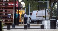 Jacksonville Sheriff's officers investigate the shooting at Jacksonville Landing on August 26, 2018 in Jacksonville, Florida./AFP