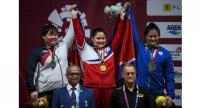 L to R) Silver medallist South Korea's Lee Hui-so, gold medallist North Korea's Kim Kuk Hyang and Thailand's Duangaksorn Chaidee pose on the podium.