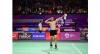 Indonesia's Jonatan Christie celebrates after beating Taiwan's Chou Tienchen to take gold in their men's singles final badminton match.