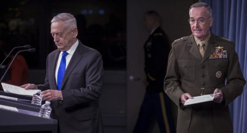 U.S. Secretary of Defense James Mattis, left, and Chairman of the Joint Chiefs of Staff Gen. Joseph Dunford, right, arrive before holding a press briefing at the Pentagon August 28, 2018 in Arlington, Virginia./AFP