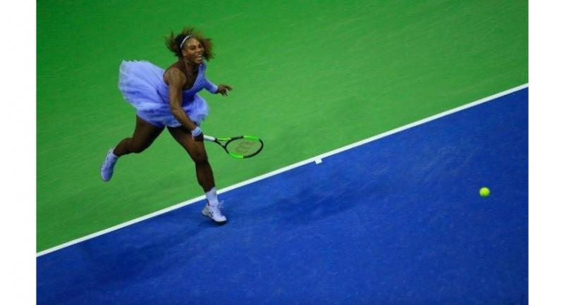 Serena Williams of the United States serves against Carina Witthoeft of Germany.