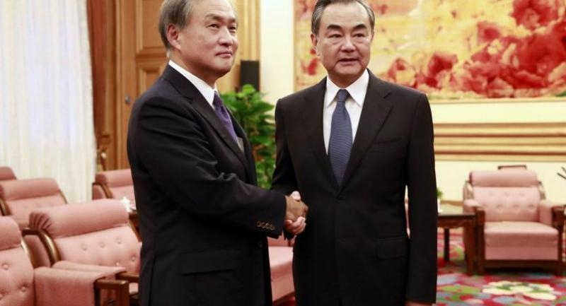 Japanese Vice Foreign Minister Takeo Akiba (L) shake hands with Chinese Foreign Minister Wang Yi (R) during their meeting at the Zhongnanhai Leadership Compound in Beijing, China on August 29.//EPA-EFE