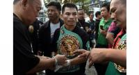FILE – Undefeated Thai boxer Wanheng Menayothin wears his WBC title belt after defeating Panamanian challenger Leroy Estrada to win his 50th straight victory on May 2, 2018 in Nakhon Ratchasima. / AFP PHOTO / LILLIAN SUWANRUMPHA