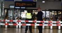 Officials stand inside a cordonned-off area at The Central Railway Station in Amsterdam on August 31, 2018, after two people were injured in a stabbing incident./AFP