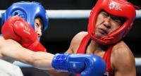 South Korea's Oh Yeon-ji (blue) fights against Thailand's Sudaporn Seesondee (red) in their women's light (60kg) boxing final.