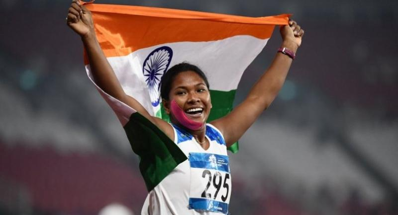 ndia's Swapna Barman celebrates winning the women's 800m heptathlon athletics event during the 2018 Asian Games in Jakarta on August 29, 2018. (Photo by Jewel SAMAD / AFP)