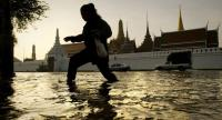 (FILES) This file photo taken on October 28, 2011 shows a woman walking through floodwaters in front of the Grand Palace near the Chao Praya river in Bangkok. // AFP PHOTO