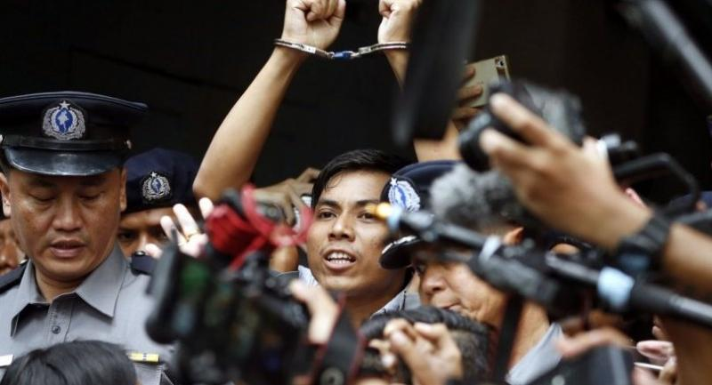 Reuters journalist Kyaw Soe Oo (C) is escorted out of the Insein township court in Yangon, Myanmar, on September 3.//EPA-EFE