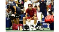 Roger Federer of Switzerland following defeat during the men's singles fourth round match against John Milman of Australia.