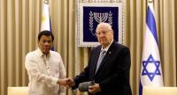 Israeli President Reuven Rivlin (R) welcomes his Philippine counterpart Rodrigo Duterte at the presidential compound in Jerusalem on September 4.//AFP
