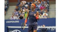 Spain's Rafael Nadal celebrates a point against Austria's Dominic Thiem during their Men's Singles Quarter-Finals match.