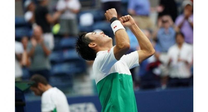 Kei Nishikori of Japan celebrates his victory over Marin Cilic of Croatia.