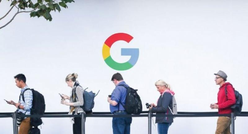 Attendees wait in line to enter a Google product launch event at the SFJAZZ Center in San Francisco, California. EU news agencies have accused the online giant of 'plundering' news content. Elijah Nouvelage/afp